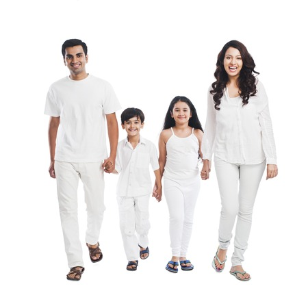 guy standing: Portrait of a happy family smiling Stock Photo