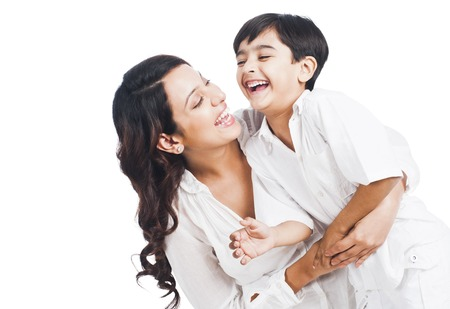 Happy mother and son smiling