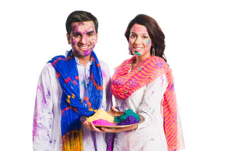 Couple celebrating Holi with Holi colors photo