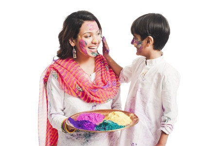 Woman celebrating Holi festival with her son