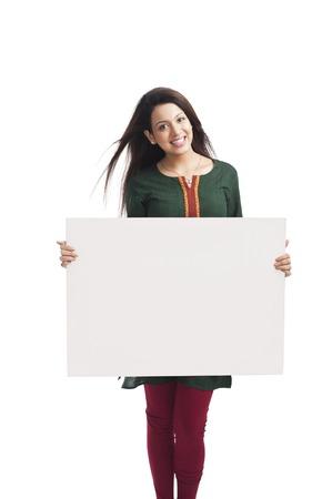 kameez: Portrait of a happy woman holding a whiteboard