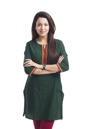 kameez: Portrait of a woman standing with her arms crossed