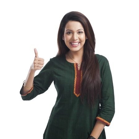 Portrait of a woman showing thumbs up sign and smiling photo