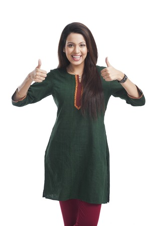 kameez: Portrait of a woman showing thumbs up sign and smiling