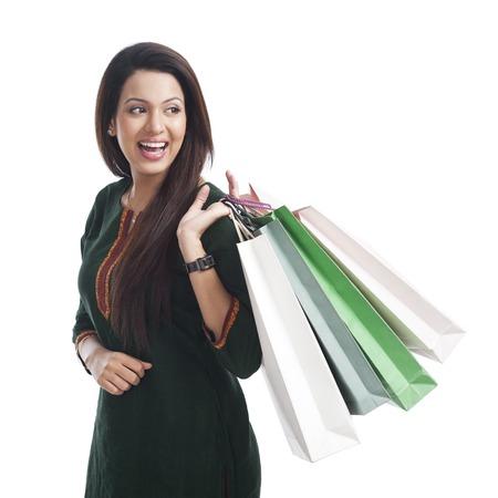 kameez: Happy woman carrying shopping bags