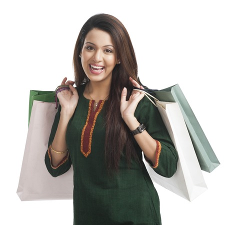 indian subcontinent ethnicity: Portrait of a happy woman carrying shopping bags