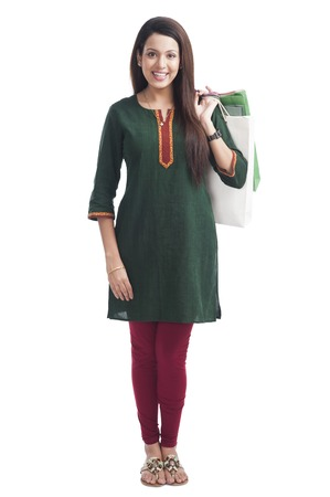 kameez: Portrait of a happy woman carrying shopping bags