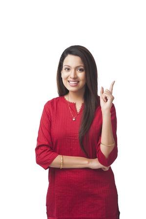 kameez: Portrait of a happy woman pointing