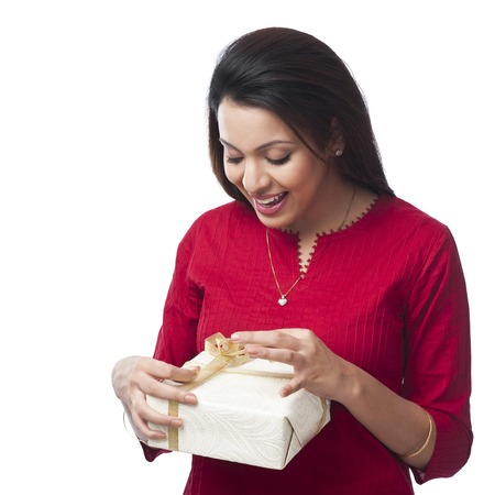 kameez: Close-up of a happy woman opening a gift box