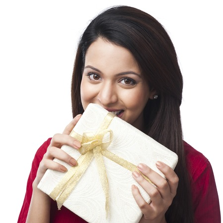 kameez: Portrait of a happy woman holding a gift box Stock Photo
