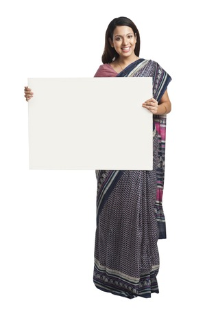 indian subcontinent ethnicity: Woman holding at a whiteboard and smiling