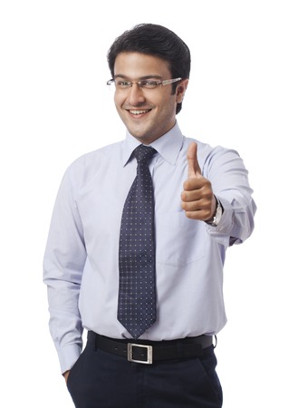 Businessman gesturing thumbs up sign photo