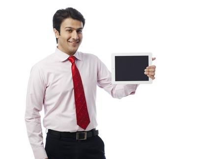 Portrait of a businessman showing a digital tablet photo
