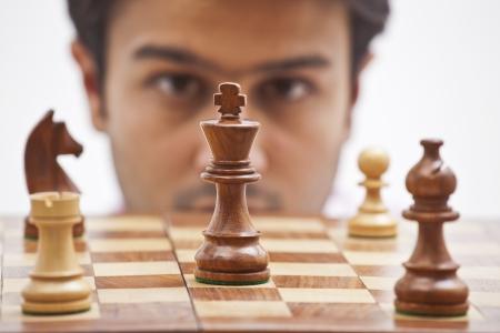 Businessman playing chess photo