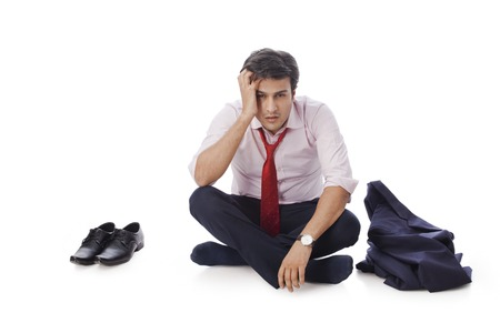 Businessman sitting on the floor and looking depressed photo