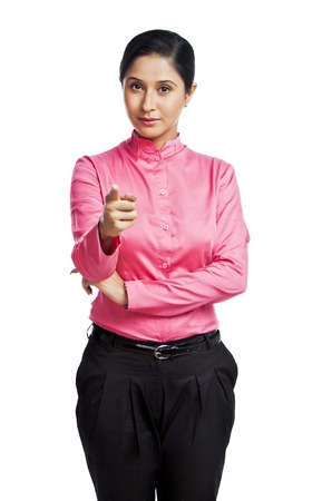 Portrait of a businesswoman pointing photo