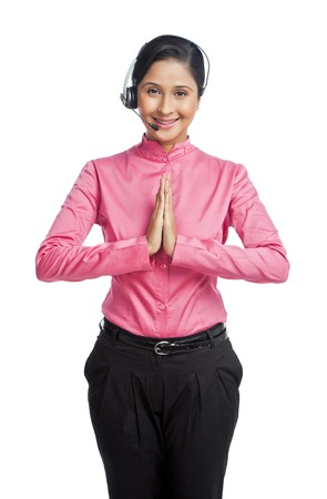 Portrait of a female customer service representative making greeting gesture photo