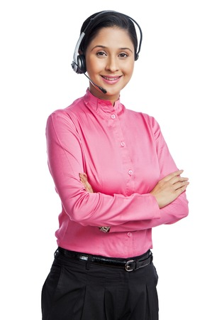 Portrait of a female customer service representative with her arms crossed photo