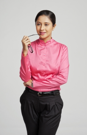 Close-up of a businesswoman holding eyeglasses and thinking Imagens