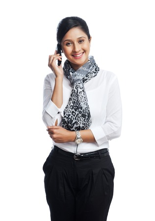 Portrait of a businesswoman talking on a mobile phone and smiling photo