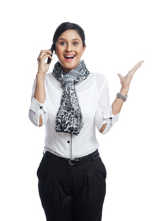 Businesswoman talking on a mobile phone and looking excited photo