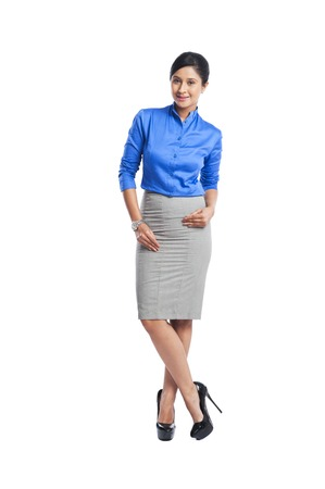 Portrait of a businesswoman smiling with her hand on hip