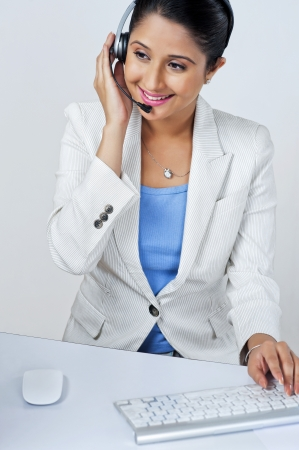 Female customer service representative using a computer photo
