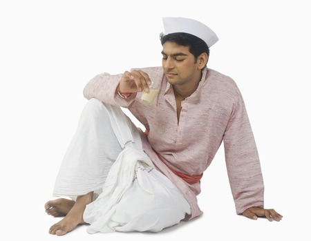 fully unbuttoned: Close-up of a man drinking tea Stock Photo
