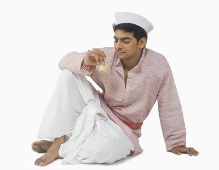 kurta: Close-up of a man drinking tea Stock Photo