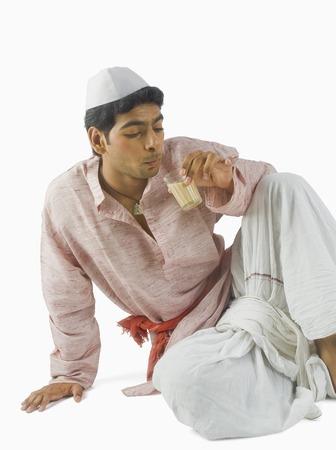 dhoti: Man drinking tea