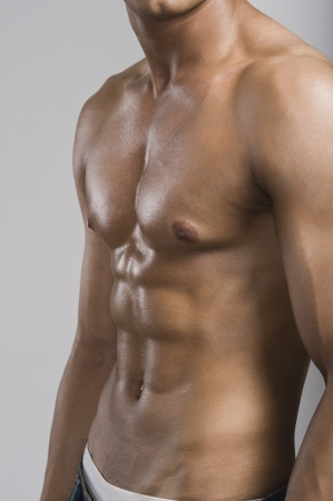 shirtless: Mid section view of a bare chested man Stock Photo