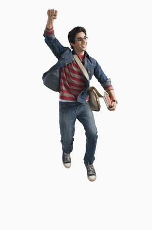 indian youth: University student jumping in excitement Stock Photo