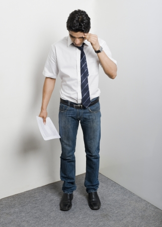 College student standing in the corner looking worried