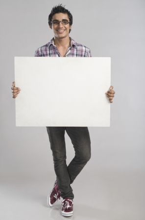 Man standing with a placard photo