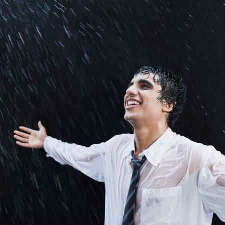 Businessman enjoying in the rain photo