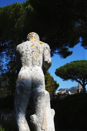Naked statue in a garden, Amalfi, Province Of Salerno, Campania, Italy