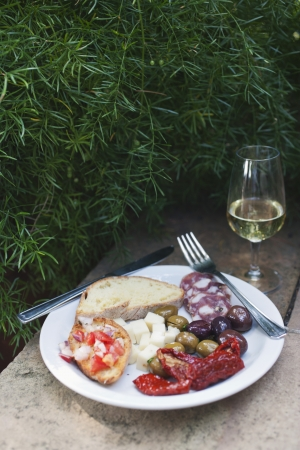 Meal served on a plate with a wineglass, Italy photo