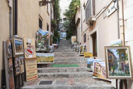 Display of paintings along the alley, Taormina, Province of Messina, Sicily, Italy