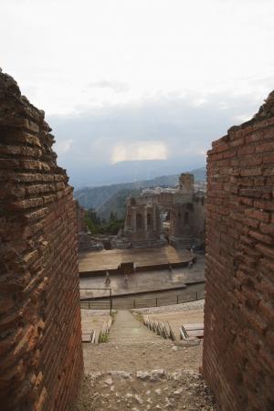 Tourists at ancient Greek theatre, Taormina, Province of Messina, Sicily, Italy Stock Photo