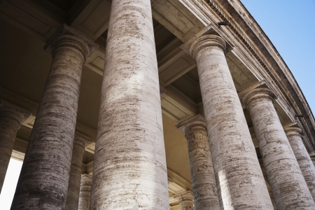 Low angle view of Berninis Column, St. Peters Square, Vatican City Stock Photo