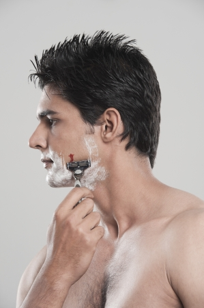 Man with shaving cut photo