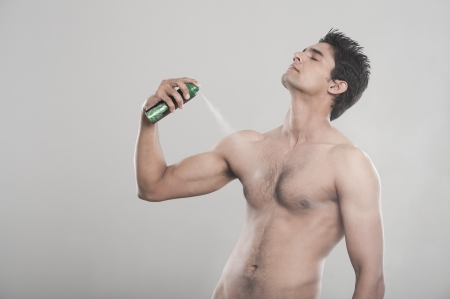 Man applying deodorant over his body