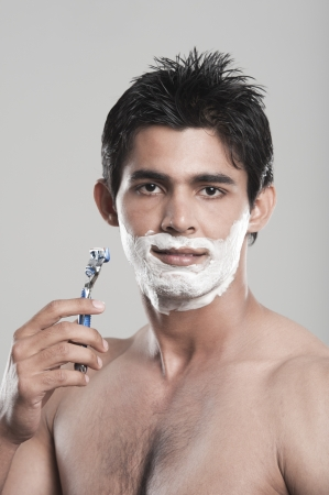 Portrait of a man shaving photo