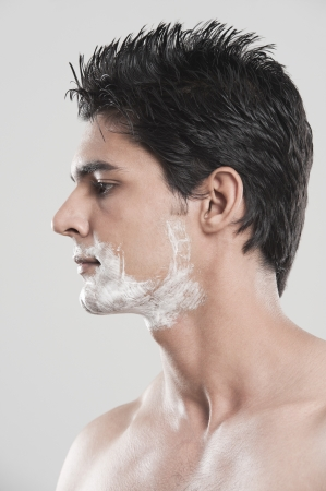 Man with shaving cream on his face photo