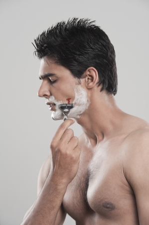Man with shaving cut photo