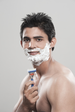 Man shaving photo