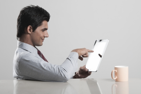 Businessman using a digital tablet photo
