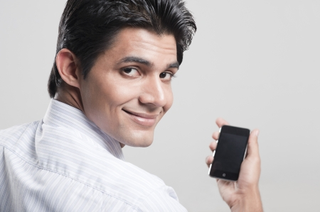 Portrait of a man holding a mobile phone