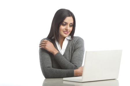 Businesswoman using a laptop Stock Photo