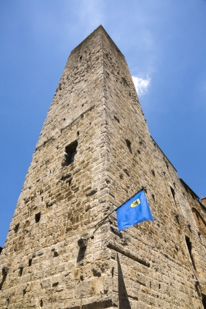 Low angle view of a tower in the medieval town of San Gimignano, Siena, Siena Province, Tuscany, Italy Stock Photo - 24774526